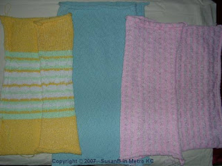3 machine knitted afghans