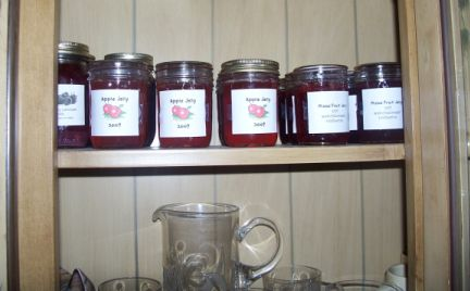 Pantry shelf full of homemade jellies and jams.