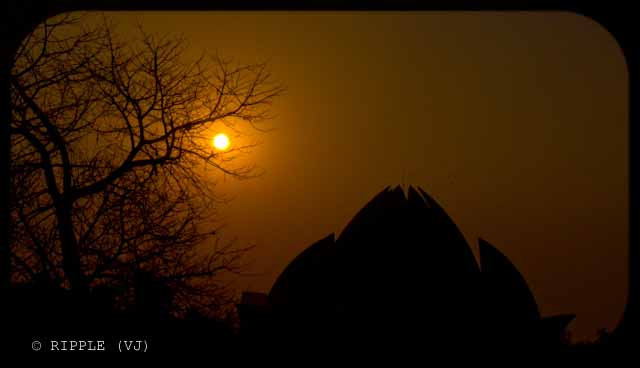 Sunset View @ Lotus Temple, Nehru Place, Delhi: The Baha'i House of Worship in Delhi which is popularly known as the Lotus Temple due to its flower like shape, is a Bahai House of Worship and also a prominent attraction in Delhi. It was completed in 1986 and serves as the Mother Temple of the Indian subcontinent. It has won numerous architectural awards and been featured in hundreds of newspaper and magazine articles.: Posted by Ripple (VJ) on PHOTO JOURNEY @ www.travellingcamera.com : ripple, Vijay Kumar Sharma, ripple4photography, Frozen Moments, photographs, Photography, ripple (VJ), VJ, Ripple (VJ) Photography, Capture Present for Future, Freeze Present for Future, ripple (VJ) Photographs , VJ Photographs, Ripple (VJ) Photography : Clicked from main entry gate when we were about to say Bye to Lotus Temple...The temple complex has lush green gardens that leave a soothing impact on the spectator. This temple attracts people from all religions, castes and faiths to its campus. Lotus Temple is one of the most visited sites of the World. Tourists from abroad, come specially to visit this magnificent lotus shaped temple...