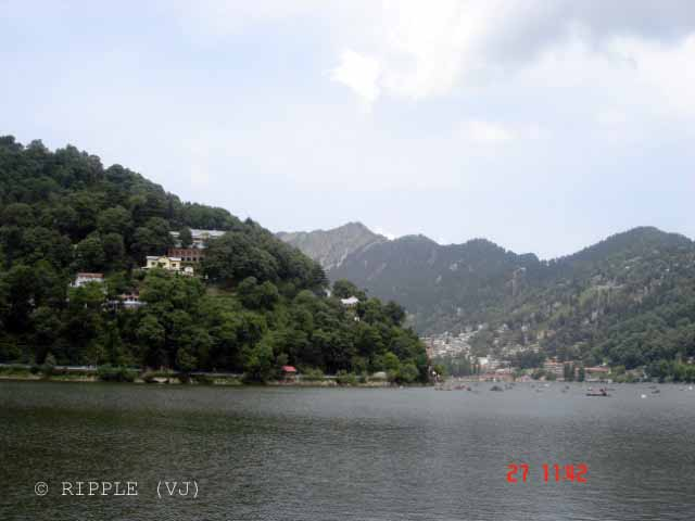 Naini Lake @ Uttrakhand, INDIA: Posted by VJ on PHOTO JOURNEY @ www.travellingcamera.com : VJ, ripple, Vijay Kumar Sharma, ripple4photography, Frozen Moments, photographs, Photography, ripple (VJ), VJ, Ripple (VJ) Photography, VJ-Photography, Capture Present for Future, Freeze Present for Future, ripple (VJ) Photographs , VJ Photographs, Ripple (VJ) Photography, Naianitaal, Uttranahcal. Uttrakhand, INDIA, People, North India :  Naini Lake obtains flows from various sourcs which consist of the hill slopes and springs. This captivating lake is a major tourist spot in Nainital as it provides tourists with opportunities of boating and yachting. There are many mythological stories related to this lake.