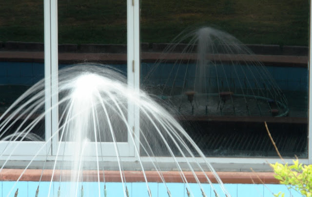 Fountain Reflection in glass window of Metro Station....