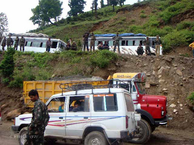 Busy route of Rohtang Pass, which leads to heavy Traffic Jams in Summers: The road through the Kullu Valley, past Manali and over the Rohtang Pass to Keylong, and Lahul and on to Ladakh, has become very busy during the summer months as an alternate a military route following the Kargil Conflict in 1999 in addition to tensions in Kashmir. Traffic jams are common as military vehicles, trucks, and goods carriers try to navigate the tight roads and rough terrain, compounded by, snow and ice at certain points and the large number of tourists vehicles. There are a lot of dhabas or Indian-style food shacks and eateries along the way.:Posted by Ripple (VJ) on PHOTO JOURNEY @ www.travellingcamera.com : ripple, Vijay Kumar Sharma, ripple4photography, Frozen Moments, photographs, Photography, ripple (VJ), VJ, Ripple (VJ) Photography, Capture Present for Future, Freeze Present for Future, ripple (VJ) Photographs , VJ Photographs, Ripple (VJ) Photography : Military People trying to clear this Jam but you know its not that easy when you have to deal hundred types of drivers on Hills :)