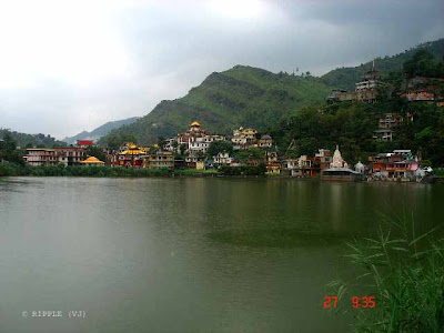 Posted by Ripple (VJ) : Rewalsar Lake is a mid altitude lake located in the Mandi district, 24 km from Mandi. Its elevation is about 1,360 m above sea level. The lake is shaped like a square with the shoreline of about 735 m. It is held as a sacred spot for Hindus, Sikhs and Buddhists alike. Legend has it that the great teacher Padmasambhava (Guru Rimpoche) used his enormous power to take flight to Tibet from Rewalsar. In Rewalsar, his spirit is said to reside in the tiny island of floating reed that drifts over the water. There are three Buddhist monasteries at Rewalsar. Rewalsar has three Hindu temples which are dedicated to Lord Krishna, Lord Shiva and to the sage Lomas.ripple, Vijay Kumar Sharma, ripple4photography, Frozen Moments, photographs, Photography, ripple (VJ), VJ, Ripple (VJ) Photography, Capture Present for Future, Freeze Present for Future, ripple (VJ) Photographs , VJ Photographs, Ripple (VJ) Photography : A view of Rewalsar Lake from Rewalsar Zoo...