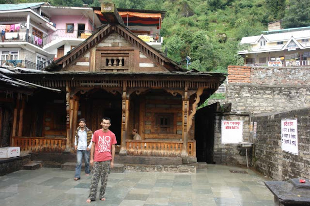 PHOTO JOURNEY through some of the main places around Manali to visit : Posted by VJ SHARMA on www.travellingcamera.com : Last week one of my office friend came to my desk and asked how is Manali.. What all I have to explore there.. and I want to spend all four days there... I serached on PHOTO JOURNEY and sent him all the relevant links.. After that I realized that I should have a post on all the places with relevant links available there... Here is the result :) : Main places to visit in Kullu, Main places to visit in Manali, Most interesting places around Kullu and Manali... I have missed few like Kasol and MalanaVashishth Temple in the town of Manu-Dev (Manali), Himachal Pradesh : Posted by VJ SHARMA at www.travellingcamera.com : Vashishth Temple is near Manali which is famous for hot water springs and sand-stone temples on river bank of BEAS... Here are few few photographs of  the place with some more details....Here is main temple @ Vashishth.. There are two separate hot-water springs on the right side... These two pools of hot water are covered and meant for men/women separately.. People take bath before darshans inside the temple...Here is another temple near the main one ....Temple is situated at the suburbs of Manali which have Hot-Water Springs having special significance for their medicinal value...The gushing waters of the hot brooks are excellent ailments for skin diseases.... Large number of people come here to have a dip in these hot streams.... The authorities have arranged separate bathing provisions for men and women....Wooden Entry Gate for Vashishth Temple with amazing carving.... These stone temples show excellent and exquisite carvings on woods....There are some very good eating outs around this temple... We spent some time at a restaurant on first floor having complete view to the market and streets there... During this, we observed that many foreigners come there for many months to learn Yoga, Meditation etc... There are lot many Yoga and Med