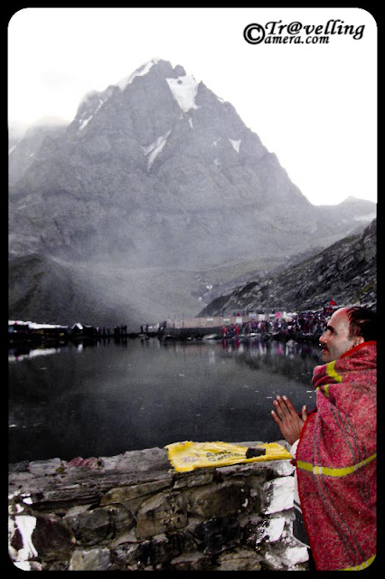 Mani Mahesh Yatra 2010 @ bharmaur, Chamba, Himachal Pradesh : by VISHAL SHARMA : Posted by Vishal Sharama @ www.travellingcamera.com : The Mani Mahesh lake is the venue of a highly revered pilgrimage trek undertaken during the month of August/September corresponding to the month of Bhadon according to Hindu calendar.. on the eighth day of the New Moon period. It is known as the 'Manimahesh Yatra'. The Government of Himachal Pradesh has declared it as a state-level pilgrimage.... Manimahesh Lake (also known as Dal Lake, Manimahesh) is a high altitude lake (elevation 4,080 metres (13,390 ft)) situated close to the Manimahesh Kailash Peak in the Pir Panjal Range  of the Himalayas.. which is in the Bharmour subdivision of Chamba district of the Indian state of Himachal Pradesh. The religious significance of this lake is next to that of the Lake Manasarovar in Tibet...The lake, of glacial origin, is in the upper reaches of the Budhil River, a tributary of the Ravi River  in Himachal Pradesh. However, the lake is the source of a tributary of the Budhil River, known as 'Manimahesh Ganga'. The stream originates from the lake in the form of a fall at Dhancho. The mountain peak is a snow clad tribal glen of Brahamur in the Chamba district originating as an off-shoot spur of the Pir Panjal Range. The highest peak is the Mani Mahesh Kailas, also called 'Chamba Kailash' (elevation 18,546 feet (5,653 m)) overlooking the lake...Me on the way to Manimahesh Yatra from Bharmaur, Chamba, Himachal Pradesh, INDIA... I enjoyed the whole journey and would be sharing more photographs of amazing hills, Water-Falls later...At some spaces roads were very adventurous and it was a thrilling journey for me.... Road inside the dense forests of Himalyas... Pir Panjal Rage in Himachal Pradesh.... More adventurous journey was from Chamba to Bharmour... Just have a look at photograph above and imagine who deep it would have been.. and I am sure, you would not be able to imagine as deep as it was :-) ... I will be sharing more photographs of this place to give an exact idea about these roads... Love it !!!People who can't afford to trek through all the hills, can have Helicopter ride to Manimahesh... Asha Ram ji Bapu also visited Manimahesh Lake this year through Helisopter... Would be sharing more photographs of Helicopter ride soon...Here is a view of Sunrise @ Pir Panjal moutain ranges of Himalyas near Mani Mahesh Lake... check out this blog in next few days for more wonderful views around Mani Mahesh Lake...Note the trekking path in the bottom of this photograph and try to imagine the surrounding... Can you imagine it???According to one popular legend, it is believed that Lord Shiva created Manimahesh after he married Goddess Parvati, who is worshipped as Mata Girja. There are many legends narrated linking Lord Shiva and his show of displeasure through acts of avalanches and blizzards that occur in the region...