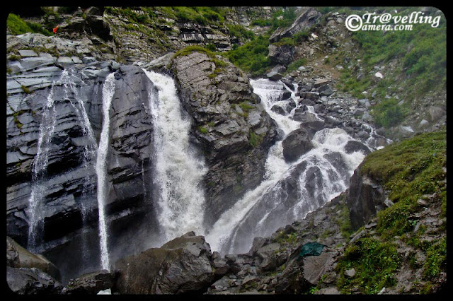 Waterfalls on the way to Mani Mahesh Lake : A lonhg trek through Pir Panjal mountain range of Himalyas : PART-2 : posted by VISHAL SHARMA at www.travellingcamera.com : Continuing with PHOTO JOURNEY to Manimahesh, here are are few more photographs of huge waterfalls on the way to Manimahesh lake in Chamba... Have a look and enjoy... Pilgrims having rest near freshening waterfalls...  I guess water of this fall was touching their body at this place... Manimahesh is considered as very important yatra and I know many of neighbors in Ghumarwin who have visited Manimahesh in last few years.. and many of them go there every year or alternate year... These are few waterfalls which could be seen from the trekking paths to Manimahesh... We had brought binoculars and could see lot many waterfalls on very high mountains of Himalayas... and its very difficult for me to describe those... Huge in size and powerful in throw of water...Here is another waterfall.. I guess it was near to Bheem Dwari and we had snacks near this, while climbing up... I don't know how to define these water streams which have multiple falls and some small streams flowing calmly towards the final destination.... but they were more attractive... How a waterfall looks has very big role of the hill from where its originating and overall shape of that hill... Also nicly composed hills give more beautiful view to these falls :-) .. I know description is not what you must be expecting... Black and White photograph of a water stream on the way to Manimahesh Lake.... There are many such streams on the way and sometimes, we needed to cross them... some of us were very excited and elder group was more careful about us :-)