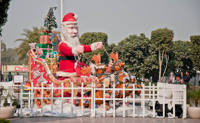 Delhi is again decorated for Christmas Celebrations - Select City Walk Mall : Posted by VJ SHARMA on www.travellingcamera.com : It is Christmas time and Delhi is full of Red & Greens... with true spirit of Christmas day !!! I know I am late to post these photographs but idea is to share the colorful view of Delhi during Christmas season... Last week, we went to Select City Mall in Saket for a day outing and saw lot of arrangements for Christmas celebrations on 25th ... It was the news that Select City Mall in Saket was going to host best evening in the city... I am not sure about the authenticity of this news but surely the mall was ready for wonderful celebrations... Check out these Photographs !!!Most of the markets in Delhi were full of Christmas goodies and decorations... Most of the markets get these goodies and decorative stuff from China or local factories in outer Delhi areas... Some of the markets like Khan Market gets these things for Europe or Australia... Saket Malls were very well decorated with all these things...In Select City Walk Mall of Saket, there was a huge Christmas tree which was made of crystals and was surrounded by shining spheres of various colors... A reflection of mall can be seen inside the leftmost sphere...This year Santa was animated at many places and was made of some special stuff... Every year, we see a new trend of all these things and in 2010, many event management companies had less resources as compared to deals they had... Now all these celebration days have become a good reason for get together and parties... Most of the Malls in NCR organized various programs during 25th December, 2010...Here is the outermost gallery of DLF Mall in Saket and it came to my mind that the money spent on all these decorations could have been better utilized for people who are sleeping on Footpaths of Delhi during these winters... But next to this decoration, mall has organized some cultural events to raise funds for an NGO who takes care of Cancer patients in various parts of INDIA... Merry Christmas Day to everyone !!!Here is a view of huge Christmas Tree inside Select City Walk Mall in Saket... It was made of of crystals only...Whole Mall (Select City walk) was decorated with various things to make everyone feel about the Christmas season in the city... Santa, Red houses with snowfall, Green trees with sparkling ornaments and what not...Just wanted to share a photographs of the mall where most of the Photographs were shot .... Select City Walk Mall in Saket, DelhiHere is another Christmas Tree outside DLF Mall in Saket... Unique styled Christmas tree....