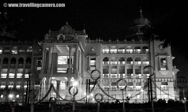 Night Photographs of Vidhan Saudha @ Banglore, Karnataka : Posted by VJ SHARMA on www.travellingcamera.com : Before going to Banglore I had heard a lot about Vidhan Saudha... Yes, you read it right : 'Saudha'... In North India Legistrative Assembly is called as Vidhan Sabha and this was the first change I noticed after reaching there...The Vidhana Soudha is located in Bangalore (Bengaluru) and its a seat of the state legislature of Karnataka. Vidhan Saudha has a very attractive building and the architecture has Indo Saracenic and Dravidian styles... Vidhan Saudha wa constructed in 1956 which I know from Wikipedia..Before going to Banglore I had heard a lot about Vidhan Saudha... Yes, you read it right : 'Saudha'... In North India Legistrative Assembly is called as Vidhan Sabha and this was the first change I noticed after reaching there...The Vidhana Soudha is located in Bangalore (Bengaluru) and its a seat of the state legislature of Karnataka. Vidhan Saudha has a very attractive building and the architecture has Indo Saracenic and Dravidian styles... Vidhan Saudha wa constructed in 1956 which I know from Wikipedia..I wanted to visit this place during day time but always plans changed and didn't get time to come here.. On the last day of my trip my friend brought me here at 1:00 am and I had no tripod... Some security people were also roaming around there and I didn't want to take any risk there.. So most of the shots were clicked within 5 minutes of duration by stopping our car in front of the building... But finally I got something and of-course, something is better than nothing :) shaky photograph of main entry of Vidhan Saudha in Banglore... A volvo bus which goes to airport was just crossing....While we were driving back for home, I saw another beautiful building and it was Banglore Post Office building... There is a red light near to this building and we were waiting for it to turn green...Black and White photographs hide all the noise due to high ISO :)
