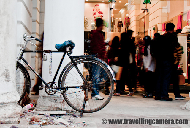 A Quick walk around Inner Circle of Cannought Place in Capital City of India - Delhi : Posted by VJ SHARMA on www.travellingcamera.com : It was a weekend during november 2010 when MTb Photographers decided to meet in Delhi... Idea was to meet on a photo-shoot but some of them got busy and plan got delayed... During the day we were only two - Me and Ankit ... We spent some time around Jantar Mantar and came back to CP in evening.. Here are few photographs from Connaught Place in Delhi... Check Out !!Wonderful lighting around central park in  the middle of Connaught Place !!!There is a huge park in the middle of Inner Circle and its exactly on top of Metro Station of Rajeev Chowk!!!Central Park has only on entry open  but folks jump-in and out from almost every place... There is not point of such security... You know Cameras are not allowed inside the park and security folks will not allow you to go inside with any still or video camera.. All these shots are taken from outside the park and you can see people jumping off the boundaries of this park !!!Since we were not allowed inside the park with cameras, we thought of spending some time around inner circle while doing some chit chat !!!A bad photograph but just wanted to share that tourists in delhi buy lot of such stuff from places like CP, Dilli Haat and other places...Cycle of one of the sales boy in these BIG showrooms of Cannought place !!!Ankit and Jimsee : Two talented Photographers !!! walking around inner circle of Delhi...Thousands of people come to Cannought place in a day and its very much crowded during the evening... And if its a festive season limits are crossed and place look like a huge celebration area with lots of lighting arrangements and what not !!!Folks who carry most of the stuff to these bug places for maintenance.. Here is one person going to pick some raw material and cement for maintenance of Palika Market which is near to the inner circle of Cannought Place !!!
