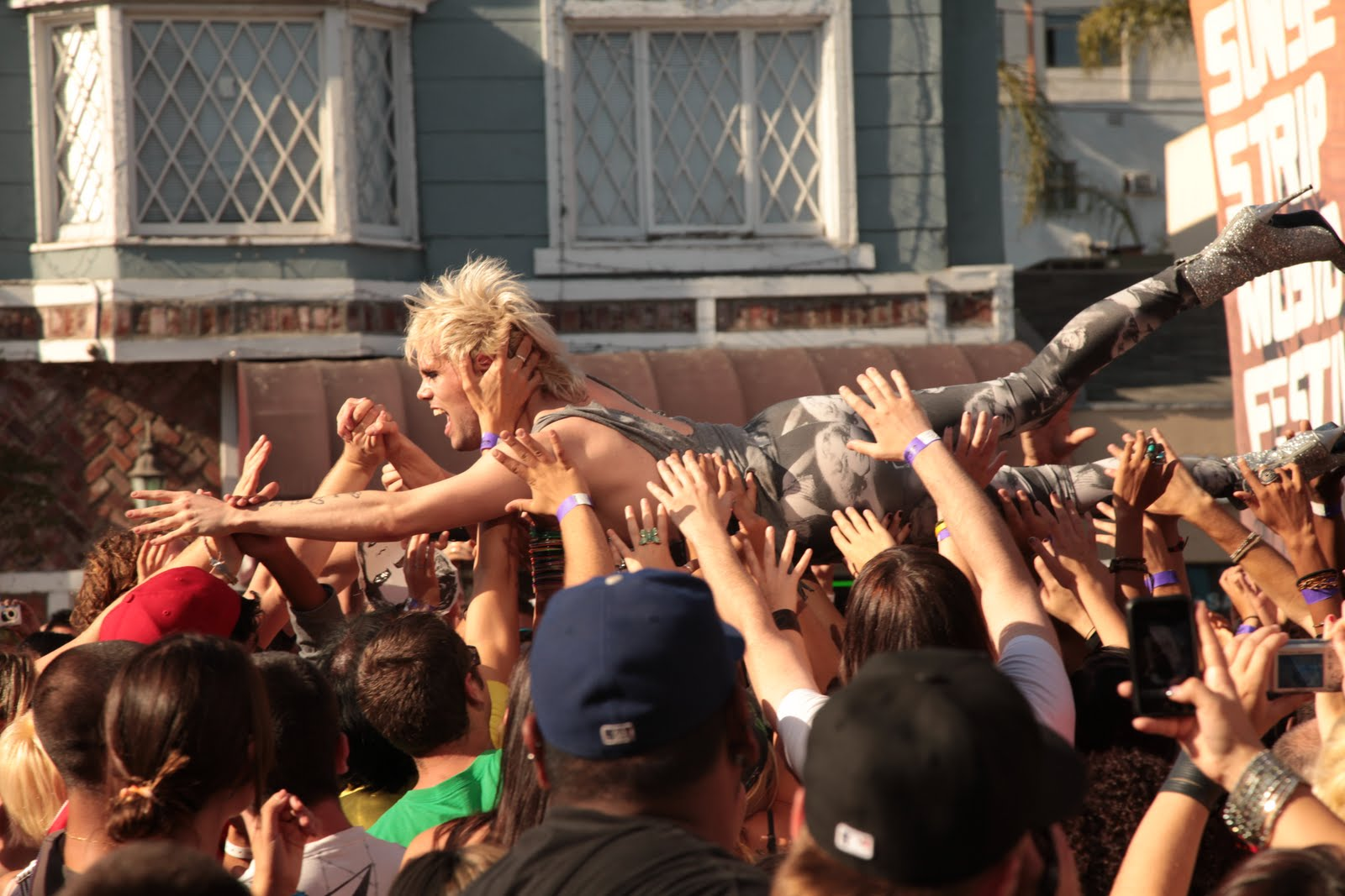 Crowd surfing stripped woman