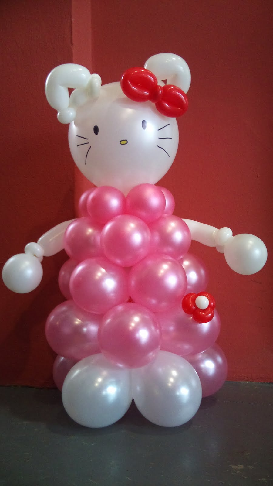 Balloon Sculpture Of A Large Birthday Cake