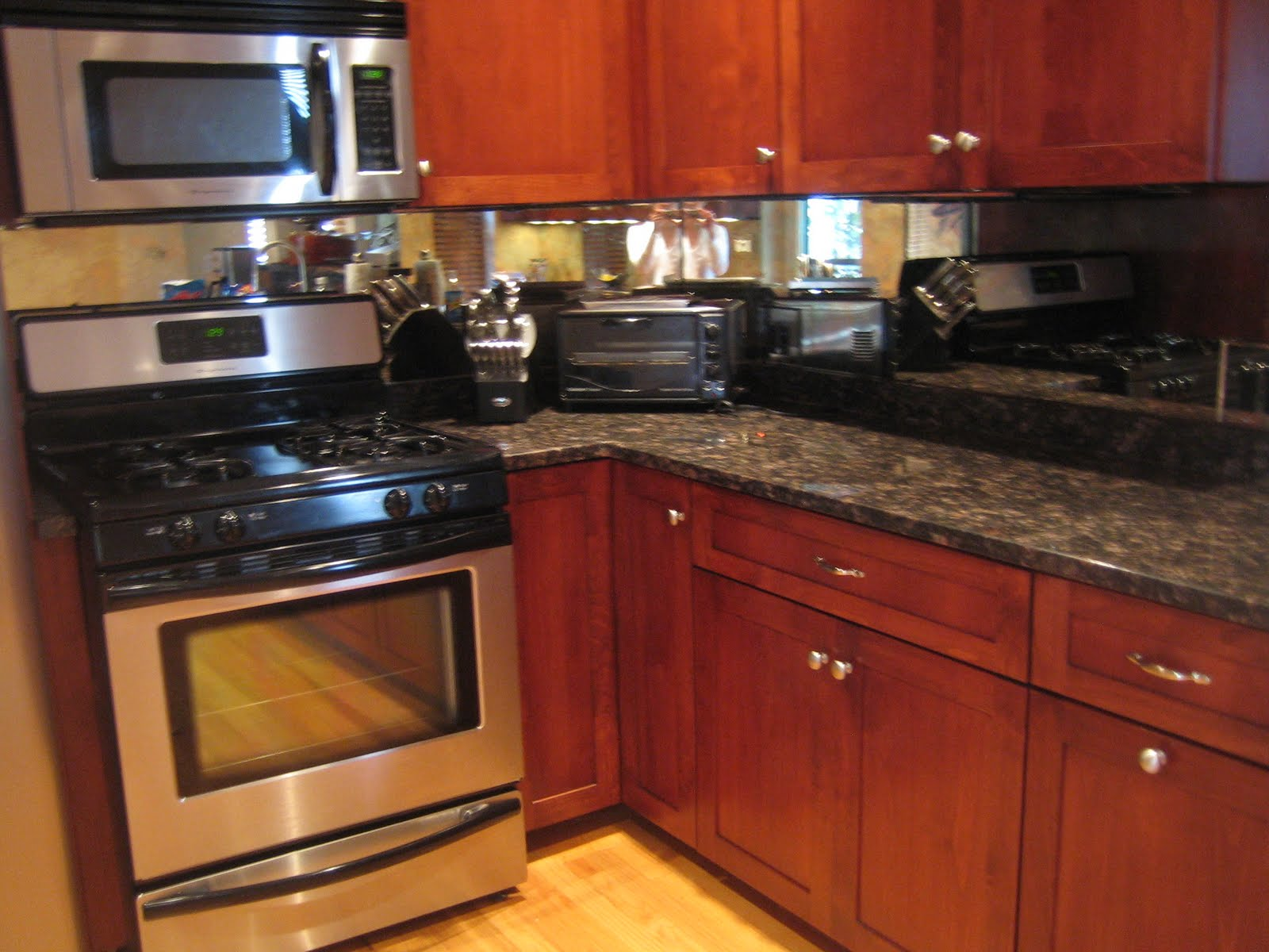 Kitchens with Mirror as Backsplash