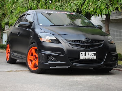 Toyota Yaris flat black orange wheels