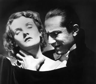 Mina (Helen Chandler) as she is about to receive the kiss of undeath from Dracula (Bela Lugosi)
