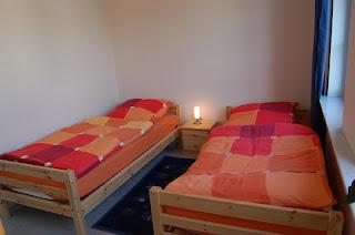 Ferienwohnung Franz Travemünde. Ferienwohnung 2: Schlafzimmer mit Einzelbetten.