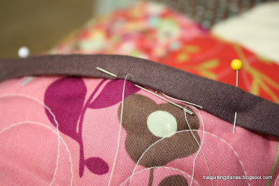 Tutorial on binding a quilt featured by top US quilting blog, Diary of a Quilter