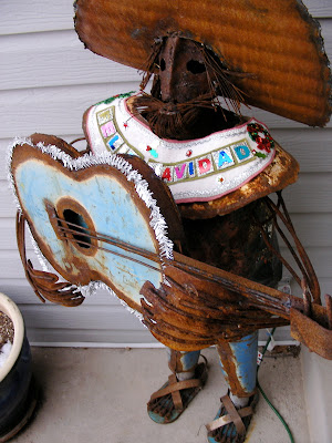 front stoop for Christmas, mexican mariachi metal statue