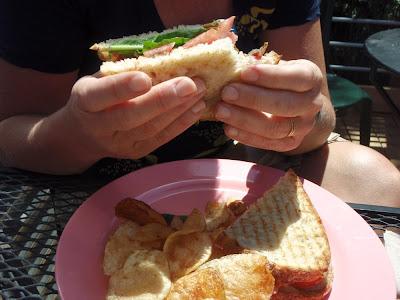 enjoying a sandwich, outdoor eating