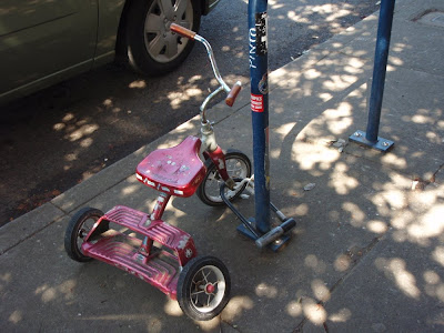 tricycle locked to a pole in Portland