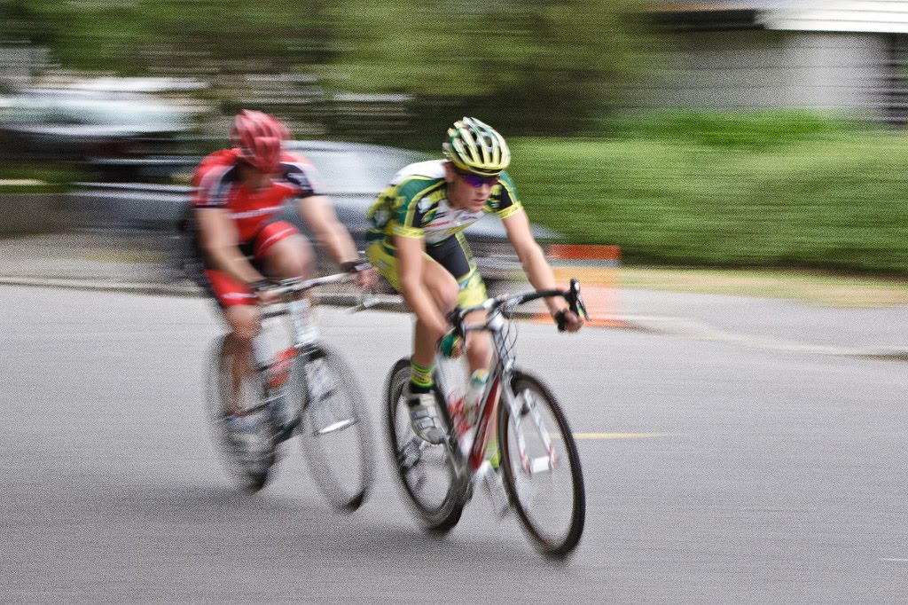 Michael Vink, in the green and yellow, speeds past
