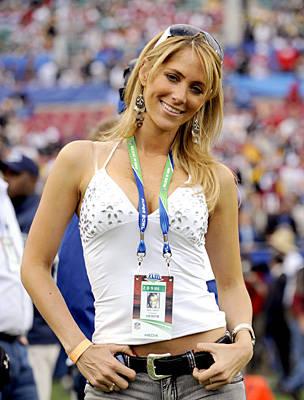 Female Sports Journalist In The Locker Room