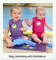 Image of two babies in colorful Baby westuits