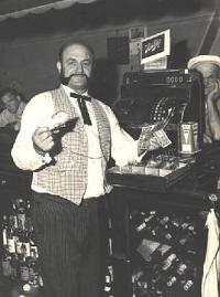 Liz's dad at his cash register in the saloon
