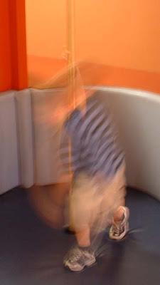 photo of a child as a blur - sliding down a pole