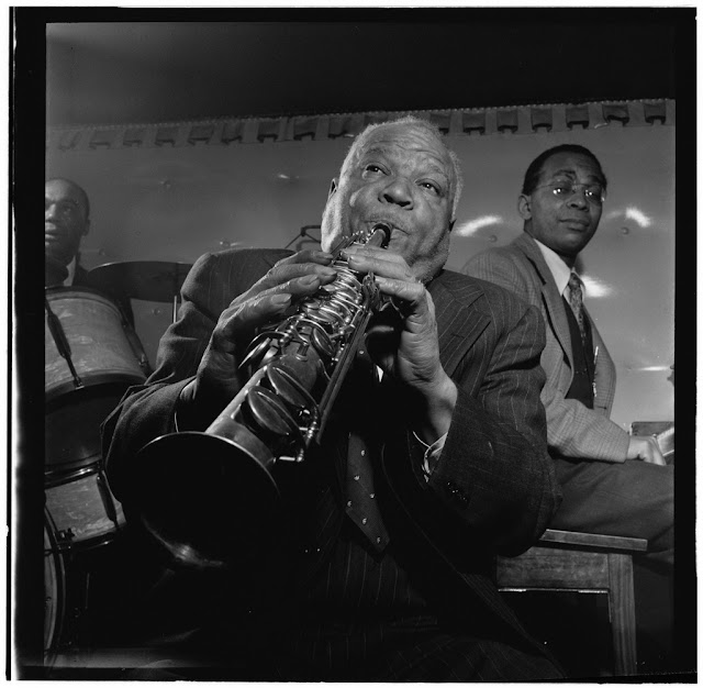 Portrait of Sidney Bechet, Freddie Moore, and Lloyd Phillips, Jimmy Ryan's (Club), New York, N.Y., ca. June 1947. Forms part of: William P. Gottlieb Collection (Library of Congress). In: The Record Changer, v. 6, no. 4 (June 47, 1947), p. 9.