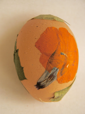 Easter egg decorated with pretty pressed flowers