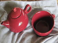 single tea pot and cup