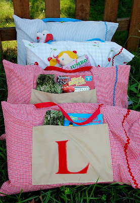 colorful pillowcases with front pockets and books in the pockets