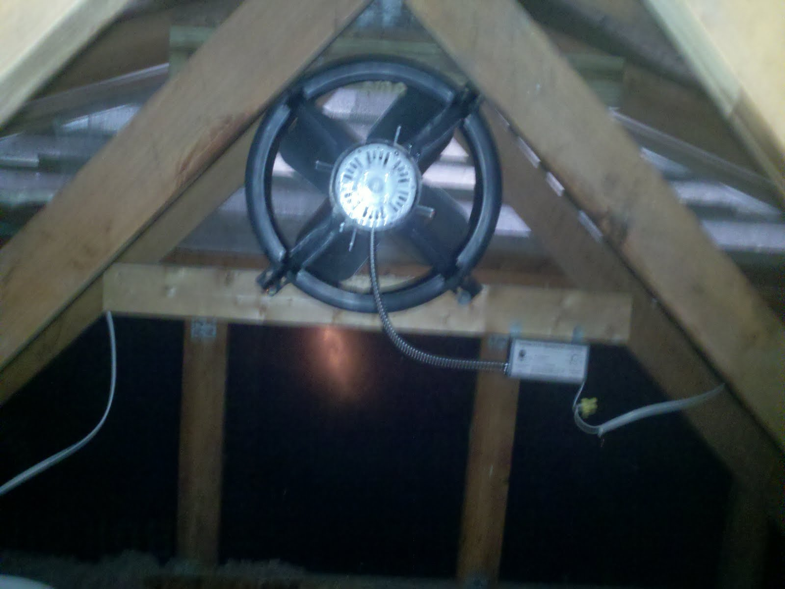 New Home Installed A Gable Attic Fan Light Outlet