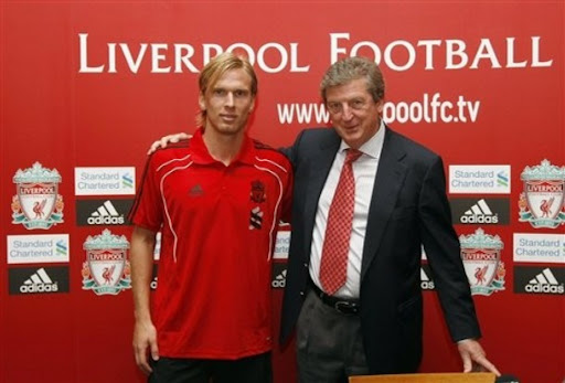 Manager Roy Hodgson and new Liverpool signing Christian Poulsen pose for photographers