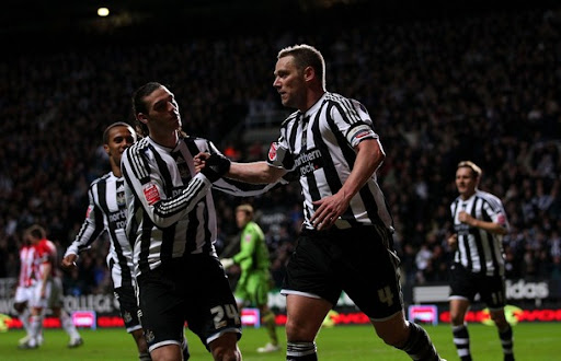 Newcastle United captain Kevin Nolan celebrates a goal with team-mate Andy Carroll