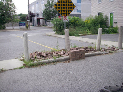 loose brick pavers in Fused Grid traffic protection on Bay Street, Ottawa