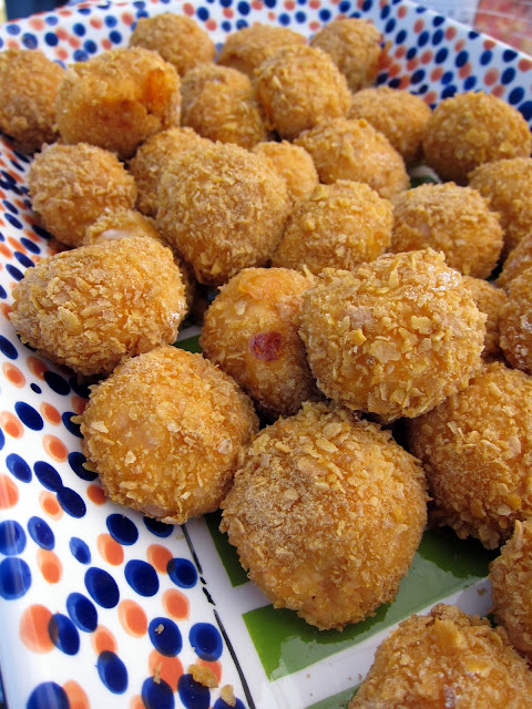 Buffalo Chicken Bites - OMG! SO good!! It is like buffalo chicken dip rolled in corn flakes and baked. Can make ahead of time and freeze for later! Cooked chicken, cream cheese, hot sauce, cheddar cheese, onion powder, flour, eggs and corn flakes. Great for tailgating and parties!