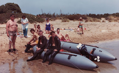 Divers and inflatable boat