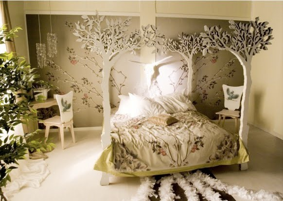 enchanted forest decor bedroom with tree four post bed leaf bedding and live plants