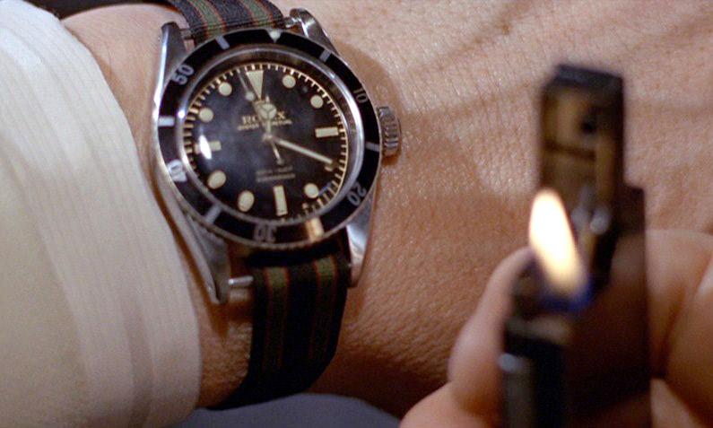 372deb077b Sean Connery alias James Bond dans le film Goldfinger va créer une légende  associée à la Rolex Submariner qu'il porte. Le NATO (ou OTAN pour les ...