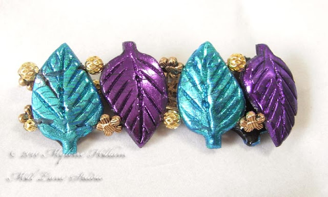 Turquoise and purple leaf bracelet cast from Friendly Plastic with gold metal spacer beads strung between the leaves.