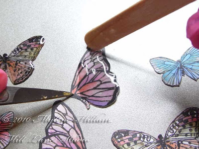 Coating the butterflies with a layer of resin
