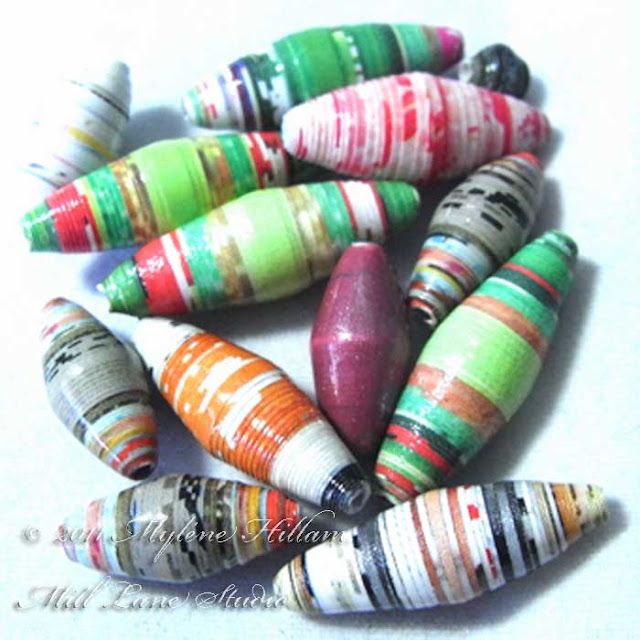 Handmade paper beads rolled from scrapbooking paper or old magazine pages