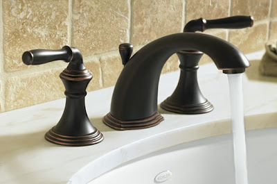 Bronze Kitchen Faucet With Stainless Appliances