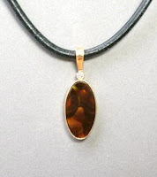 Custom made fire agate pendant for sale at Payne's Custom Jewelry
