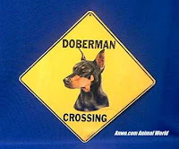 doberman pinscher crossing sign