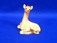 small giraffe figurine sandicast