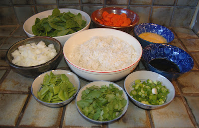 The prepped ingredients for vegetable fried rice.