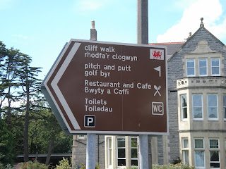 Brown Tourist Sign in Penarth - include direction to a Golf Byr