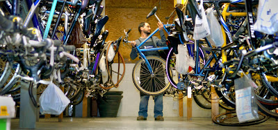 Wess Klunk of Adventure Cycling & Fitness in West Manchester Township pulls down one of the bikes he'll tune up for spring riding.